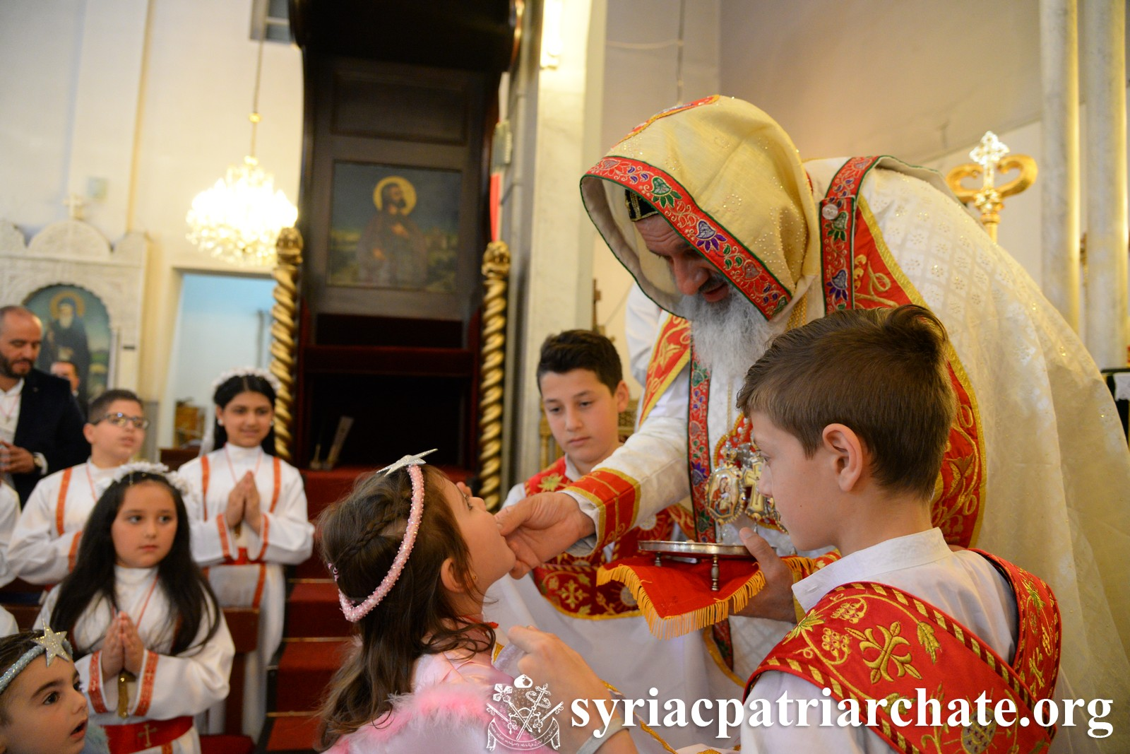 Image: Children and all who were present partook of the Holy Mysteries